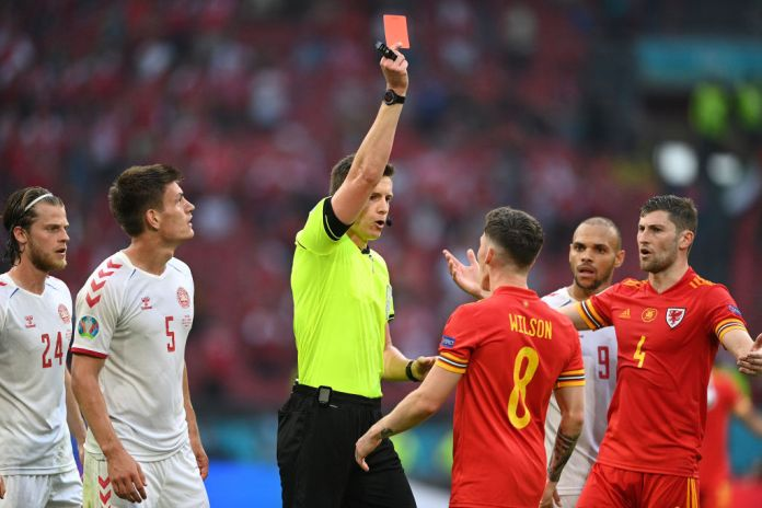 AMSTERDAM, NETHERLANDS - JUNE 26: Harry Wilson of Wales is shown a red card by Match Referee, Daniel Siebert during the UEFA Euro 2020 Championship Round of 16 match between Wales and Denmark at Johan Cruijff Arena on June 26, 2021 in Amsterdam, Netherlands.