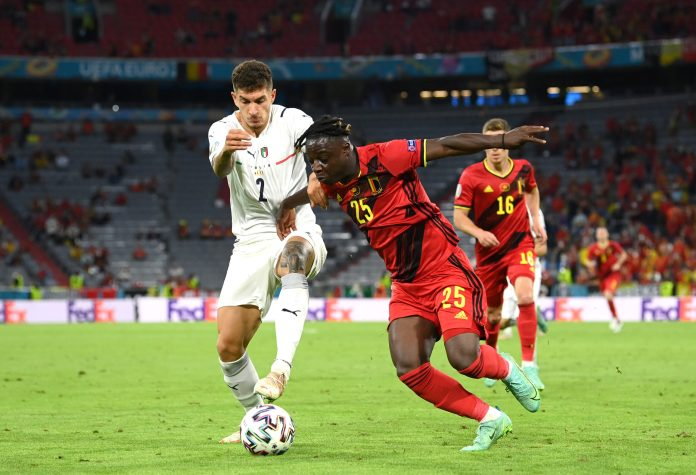 MUNICH, GERMANY - JULY 02: Giovanni Di Lorenzo of Italy battles for possession with Jeremy Doku of Belgium during the UEFA Euro 2020 Championship Quarter-final match between Belgium and Italy at Football Arena Munich on July 02, 2021 in Munich, Germany.