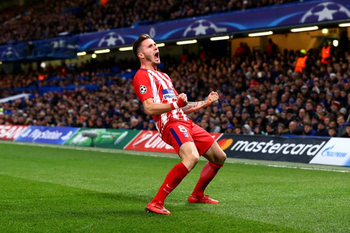 LONDON, ENGLAND - DECEMBER 05: Saul Niguez of Atletico Madrid celebrates after scoring his sides first goal during the UEFA Champions League group C match between Chelsea FC and Atletico Madrid at Stamford Bridge on December 5, 2017 in London, United Kingdom.