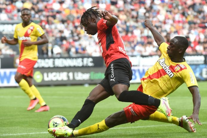 Rennes' Belgian forward Jeremy Doku (L) is tackled by Lens' Ivorian midfielder Seko Fofana during the French L1 football match between Stade Rennais (Rennes) and RC Lens at The Roazhon Park Stadium in Rennes, northern France on August 8, 2021. (Photo by JEAN-FRANCOIS MONIER / AFP) (Photo by JEAN-FRANCOIS MONIER/AFP via Getty Images)