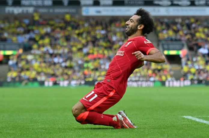 Liverpool's Egyptian midfielder Mohamed Salah celebrates scoring his team's third goal during the English Premier League football match between Norwich City and Liverpool at Carrow Road in Norwich, eastern England on August 14, 2021. - RESTRICTED TO EDITORIAL USE. No use with unauthorized audio, video, data, fixture lists, club/league logos or 'live' services. Online in-match use limited to 120 images. An additional 40 images may be used in extra time. No video emulation. Social media in-match use limited to 120 images. An additional 40 images may be used in extra time. No use in betting publications, games or single club/league/player publications. (Photo by JUSTIN TALLIS / AFP) / RESTRICTED TO EDITORIAL USE. No use with unauthorized audio, video, data, fixture lists, club/league logos or 'live' services. Online in-match use limited to 120 images. An additional 40 images may be used in extra time. No video emulation. Social media in-match use limited to 120 images. An additional 40 images may be used in extra time. No use in betting publications, games or single club/league/player publications. / RESTRICTED TO EDITORIAL USE. No use with unauthorized audio, video, data, fixture lists, club/league logos or 'live' services. Online in-match use limited to 120 images. An additional 40 images may be used in extra time. No video emulation. Social media in-match use limited to 120 images. An additional 40 images may be used in extra time. No use in betting publications, games or single club/league/player publications. (Photo by JUSTIN TALLIS/AFP via Getty Images)