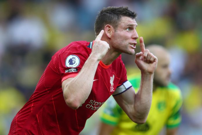 NORWICH, ENGLAND - AUGUST 14: James Milner of Liverpool shouts instructions during the Premier League match between Norwich City and Liverpool at Carrow Road on August 14, 2021 in Norwich, England. (Photo by Marc Atkins/Getty Images)