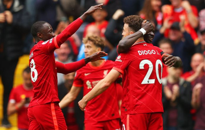 LIVERPOOL, ENGLAND - AUGUST 21: Diogo Jota of Liverpool celebrates with Naby Keita and team mates after scoring their side's first goal during the Premier League match between Liverpool and Burnley at Anfield on August 21, 2021 in Liverpool, England. (Photo by Catherine Ivill/Getty Images)