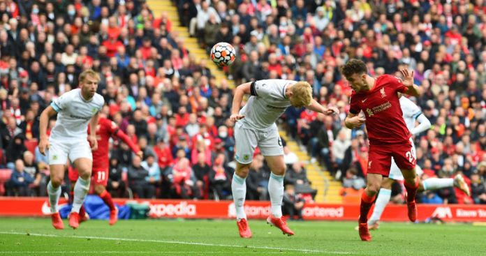 LIVERPOOL, ENGLAND - AUGUST 21: (THE SUN OUT,THE SUN ON SUNDAY OUT ) Diogo Jota of Liverpool scores the first goal during the Premier League match between Liverpool and Burnley at Anfield on August 21, 2021 in Liverpool, England. (Photo by Andrew Powell/Liverpool FC via Getty Images)