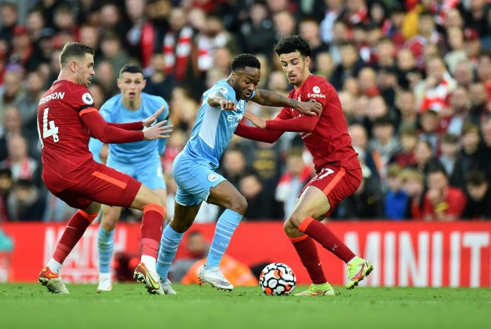 Soccer Football - Premier League - Liverpool v Manchester City - Anfield, Liverpool, Britain - October 3, 2021 Manchester City's Raheem Sterling in action with Liverpool's Curtis Jones and Jordan Henderson REUTERS/Peter Powell