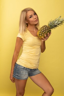 Blonde model holding a pineapple