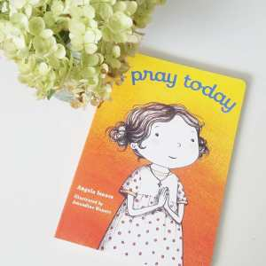 "Book ""I Pray Today"" on a white background with flowers"