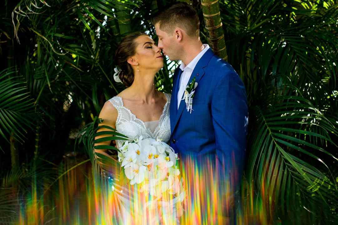 bride and groom shot with prism