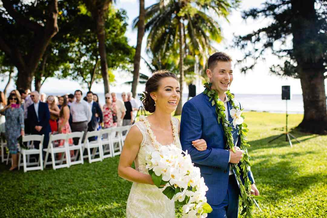 bride and groom recessional at olowalu plantation house