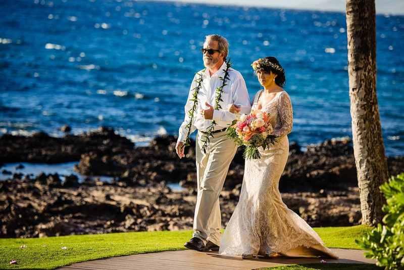 dad escorting daughter at five palms maui wedding