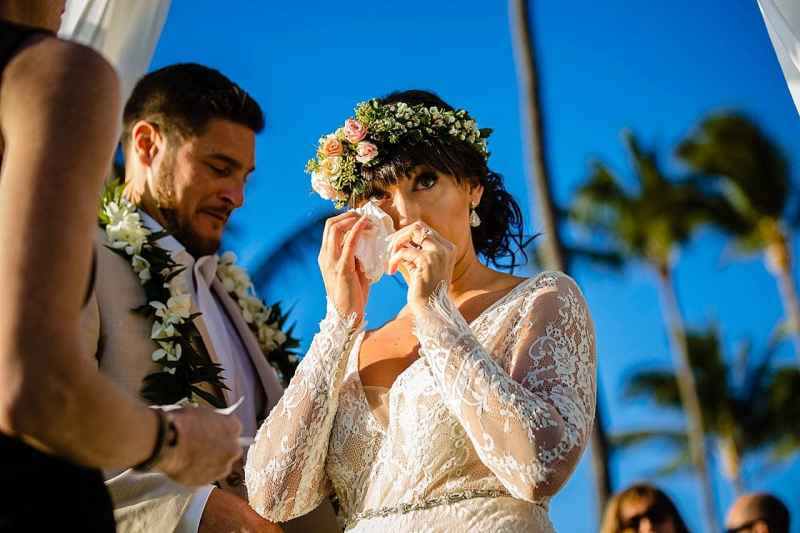 bride wiping tears at five palms maui wedding