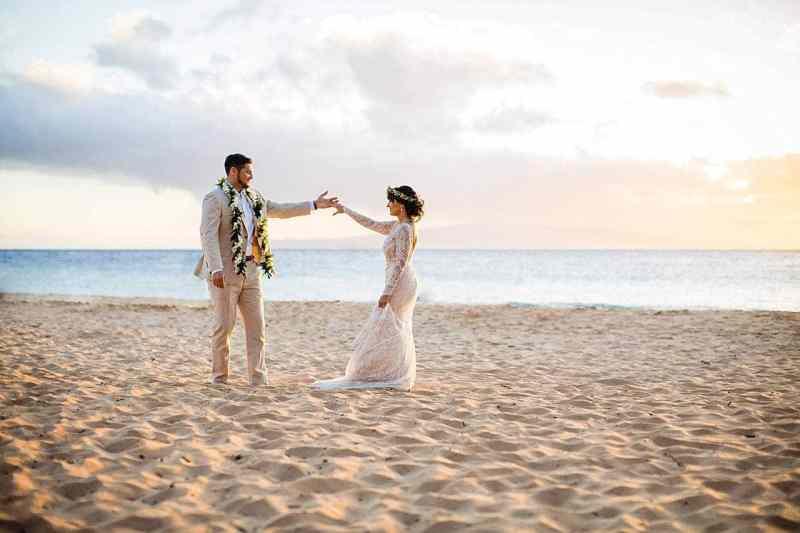 bride and groom dancing on keawakapu beach