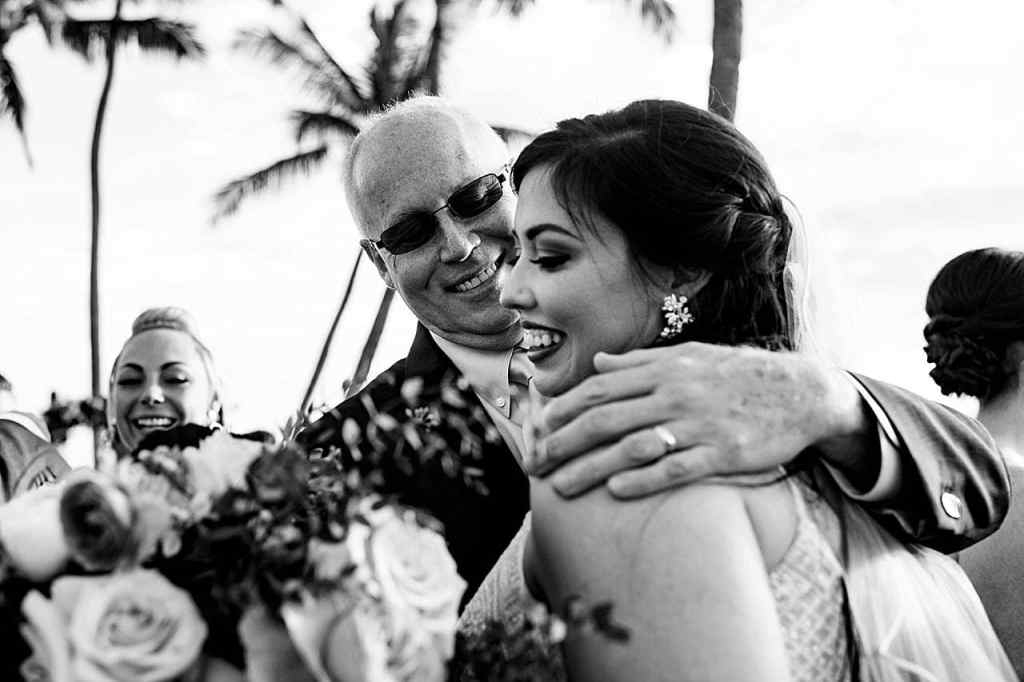 father of the bride hugging the bride