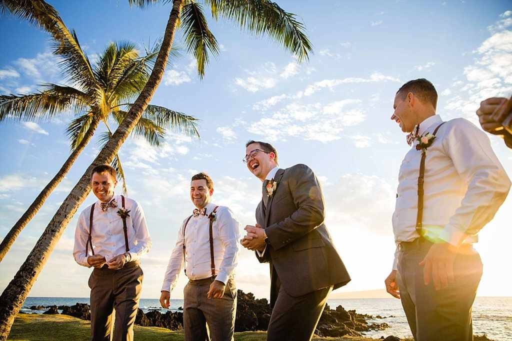 groom laughing with groomsmen at maui wedding