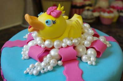 chocolate cake, sugarpaste duck in sugarpaste bubbles