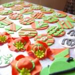 horse racing theme, custom made sugar paste decorations, horseshoes, hats, jockey shirts
