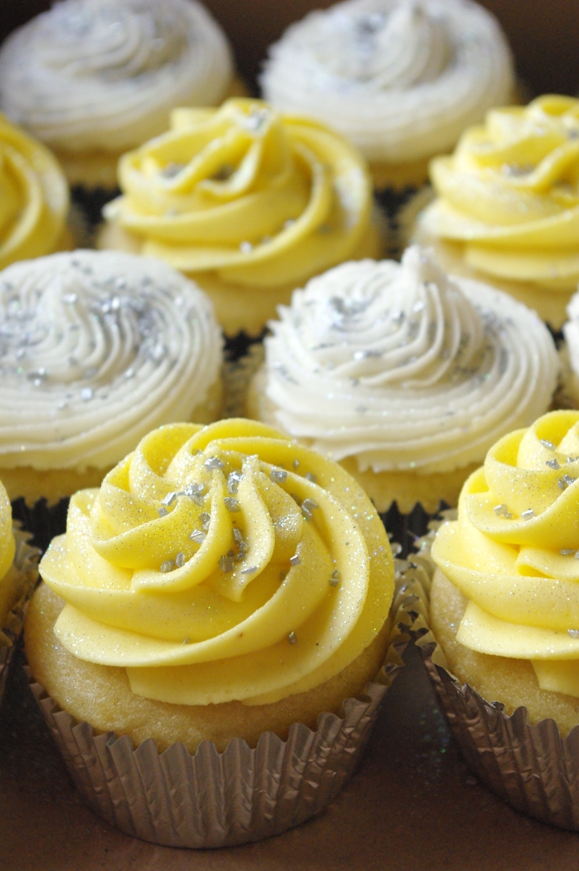 Yellow And White Icing On Vanilla Cupcakes