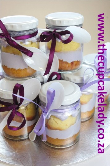 cupcake-in-a-jar wedding favours vanilla cupcake with vanilla butter icing shades of purple