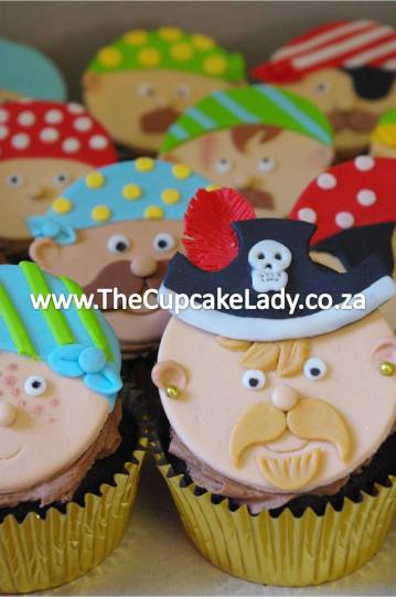 chocolate cupcakes hand crafted sugar paste pirate faces hand crafted fondant pirate faces