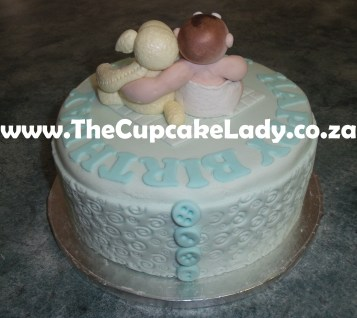 vanilla cake, vanilla butter icing, pale blue sugar paste cover, custom cake topper