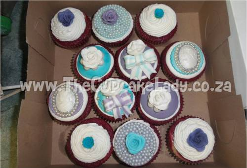 red velvet cupcakes, white vanilla butter icing, vintage themed cupcake toppers, hand made, purple and turquoise with pearls and silver accents
