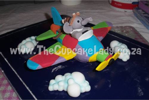 hand made, sugar paste, fondant, cake topper, custom made, aeroplane, airplane, bright colours, elephant pilot, monkey co-pilot