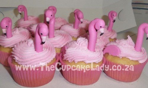 vanilla cupcakes, pink paper cups, pink vanilla butter icing, custom made pink sugar paste pink flamingo necks