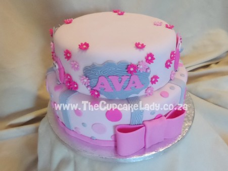 Vanilla cake with vanilla butter icing - the top tier gluten free - decorated in a pink and grey colour scheme with polka dots and sugar paste owls.