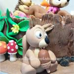 vanilla cake with vanilla butter icing, made to look like a tree stump and decorated with hand made sugar paste fox, fawn, hedgehog, and squirrel, for a woodland-themed baby shower, cake artist, sugar artist, Vorna Valley, Midrand