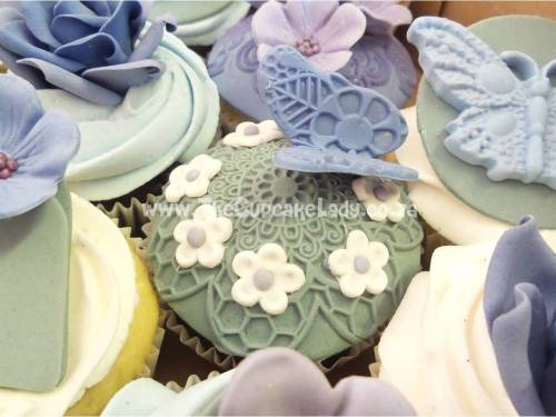 shades of purple and grey, sugar roses, sugar hearts, sugar butterflies, sugar flowers and pearls, cupcakes and cake, wedding cake and cupcakes