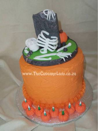 Midrand cake artist, cupcakes, cakes and sugar art. A halloween themed birthday cake - layers of chocolate and vanilla cake with bright orange buttercream. The chocolate cake is coloured black! The birthday candles were put into little sugar paste pumpkins, and the cake topper was hand made.