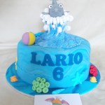 Cake artist Midrand. Cakes, cupcakes, sugar art. Custom made. Hand made. single tier vanilla cake, with a hand made sugar paste dolphin, beach ball, coral and seashells as removable cake topper, cake artist, sugar artist, Vorna Valley, Midrand