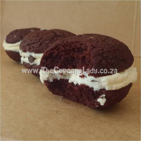 Midrand, cakes, cookies, custom sugar art, And now for something, completely different... Angel Pies!!! This are two soft cookies sandwiched with icing!!! Yum!!! In the picture here are chocolate Angel Pies with a caramel butter icing and chocolate chips, and a range of flavours are available - you can even have them dipped in chocolate! They are about the same size portion as a single cupcake, and the perfect accompaniment for coffee or ice cream!