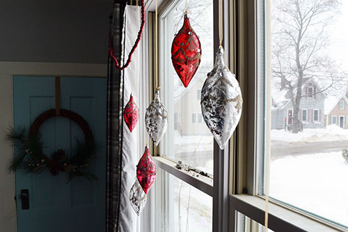 Christmas Ornaments Hanging In Windows 2013