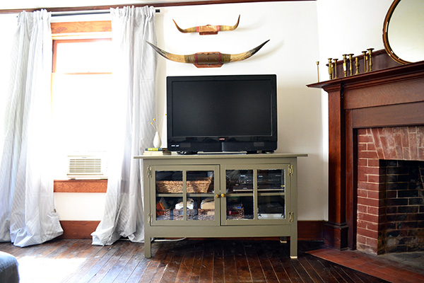 Muddy Green Painted Media Cabinet In A Living Room