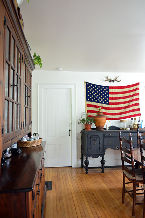 Farmhouse renovation progress in the dining room with an american flag