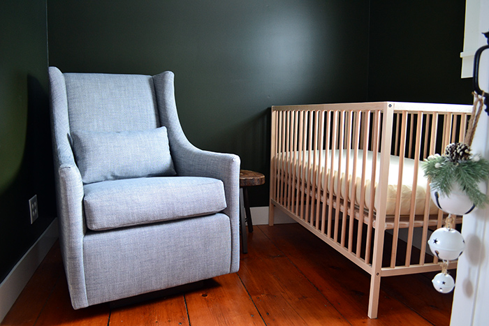 Layout for a small nursery featuring a West Elm glider and Ikea crib