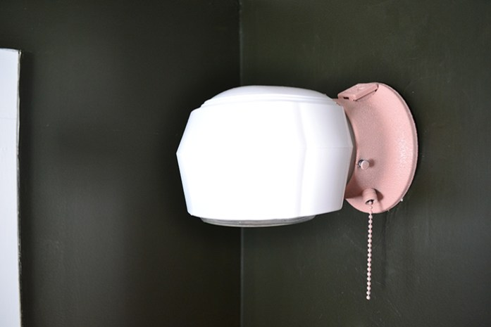 An inexpensive light fixture spray painted pink