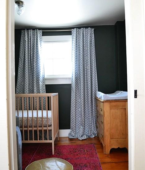 Blue nursery curtains from Anthropologie in a dark nursery