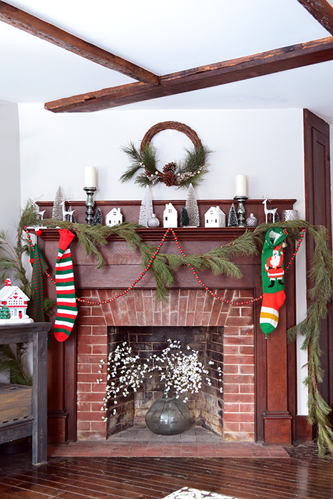 Simple Christmas decor mantle featuring vintage wood beads and heirloom stockings