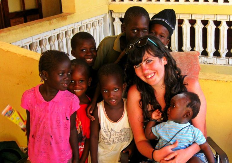 me surrounded by beautiful smiling Senegalese children.