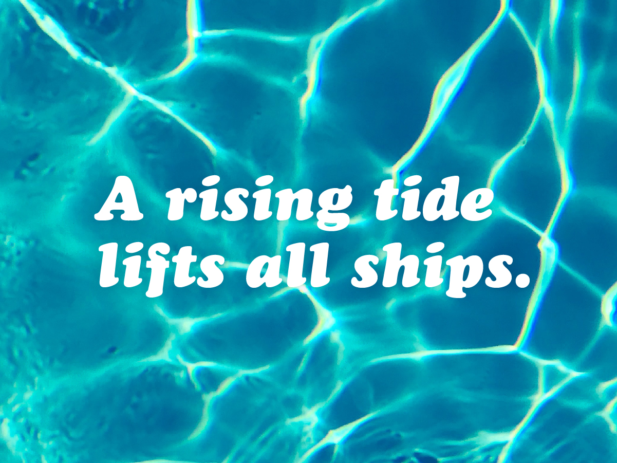A rising tide lifts all ships type on image of water