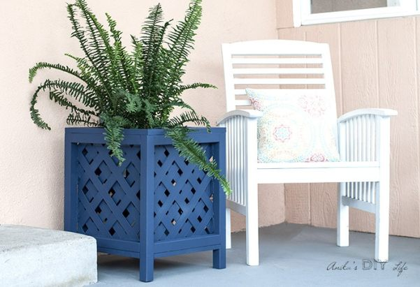 Navy blue lattice planter box in patio with plants