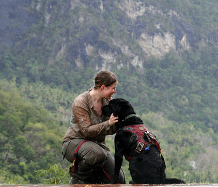 Elizabeth Seely with conservation canine Tucker in St. Lucia
