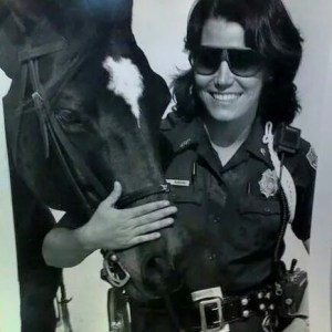 Beth Clifton as a Miami Beach mounted police officer,  with her heroic horse Raven.  who once kept a bad guy at bay. (Miami Herald photo)
