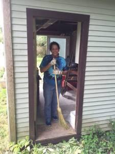 Beth with the broom. (Merritt Clifton photo)