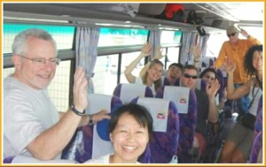 Mark Berman, left front, with Taiji protesters including Ric O'Barry in the back of the bus. (EII photo)
