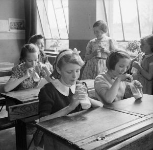 Girls drinking milk at Baldock County School, Hertfordshire, U.K., in 1944.