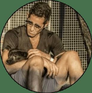 Jeffrey Beri dog rescuer holding a dog