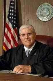 Nueces County District Judge Jose Longoria.